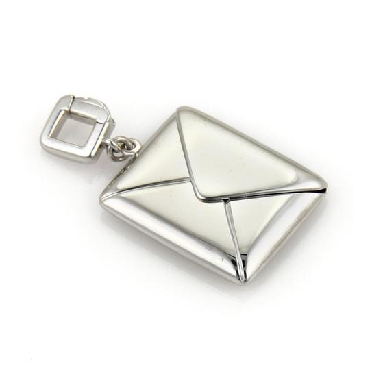 Preload https://img-static.tradesy.com/item/22425415/louis-vuitton-15409-envelope-that-opens-up-in-18k-white-gold-charm-0-0-540-540.jpg
