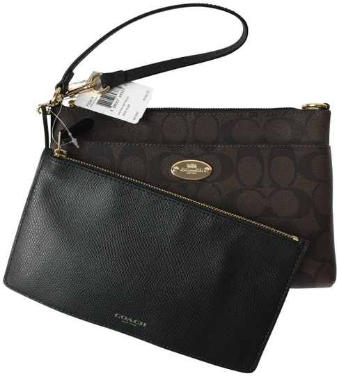 Preload https://img-static.tradesy.com/item/22426321/coach-signature-and-pouch-brown-black-wristlet-0-2-540-540.jpg