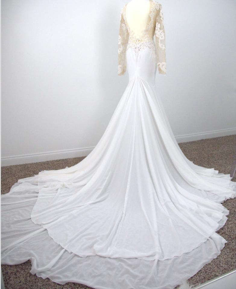 White lace cheffon one of a kind traditional wedding dress for Michael medina wedding dress