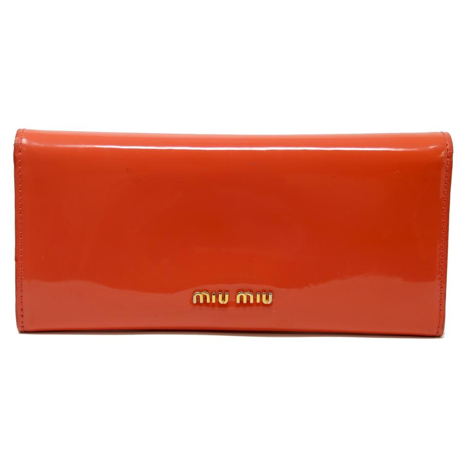 2c5de6bbfd9c Miu Miu Signature Coral Patent Leather Bow Logo Flap-Over Long Wallet Image  0 ...
