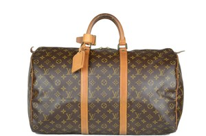 LOUIS VUITTON Lv Keepall Monogram Canvas Tote in Brown