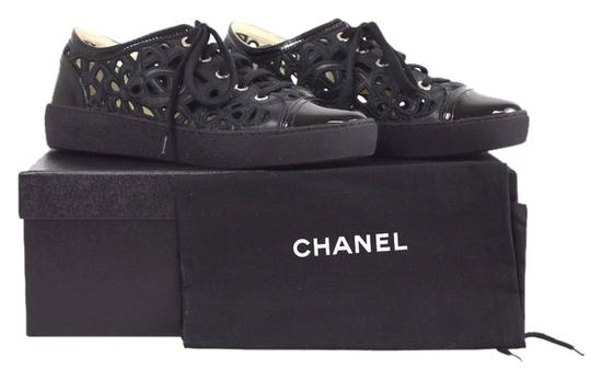 Preload https://img-static.tradesy.com/item/2244899/chanel-black-embroidered-floral-cutout-patent-leather-cap-toe-sneakers-size-us-85-0-0-540-540.jpg