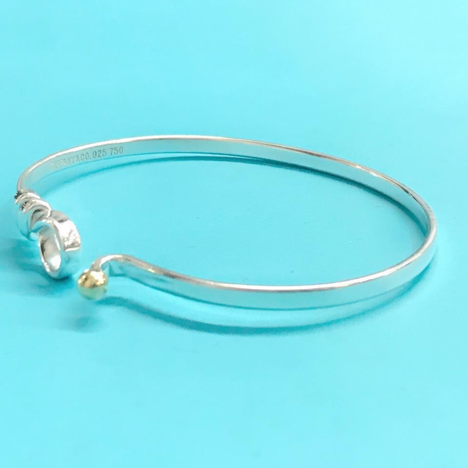 f2b7ac379 Tiffany & Co. 18 Karat Yellow Gold and Sterling Silver Love Knot ...
