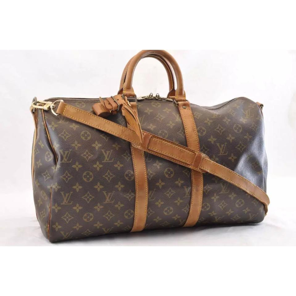 9905f2976781 Louis Vuitton Keepall Duffle 45 with Strap Bandouliere Monogram Canvas  Weekend Travel Bag