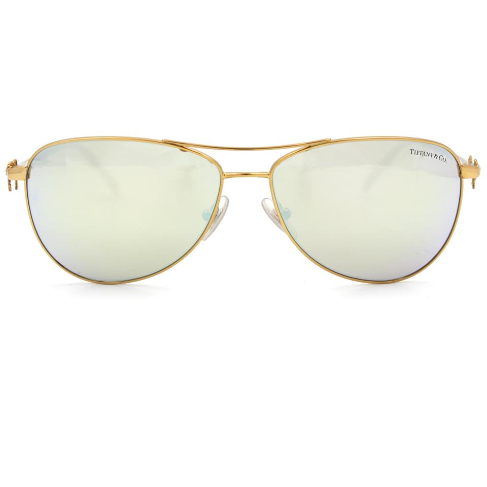 92be3339ea16 Tiffany & Co. Twist Aviator Sunglasses Gold frame and Mirror Lens. 12345678