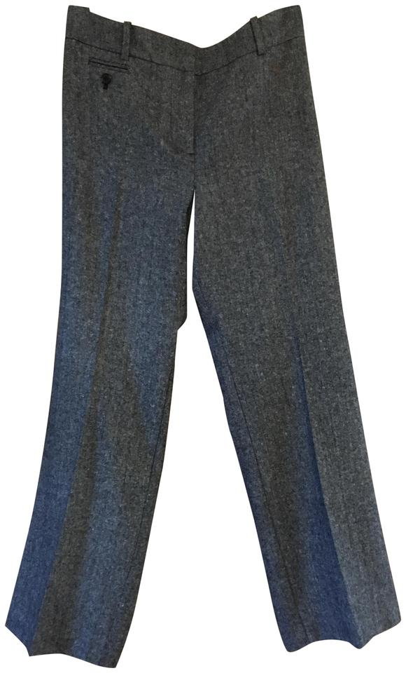 Fringed trousers Color: black Partially lined Wide leg High waist Cropped Golden metal decorative buttons Side slit pockets Rear welt pockets Zip and hooks closure Composition: 90% cotton 10% viscose, lining % polyester. Made in Italy.