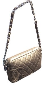 Chanel Wristlet in metallic gold