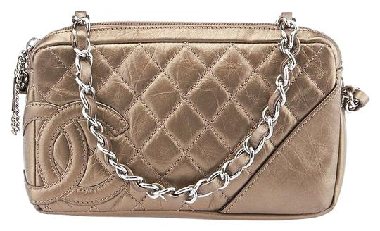 Preload https://item5.tradesy.com/images/chanel-metallic-gold-leather-wristlet-2246804-0-1.jpg?width=440&height=440