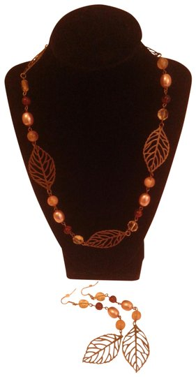 Preload https://item1.tradesy.com/images/brushed-brown-gold-new-leaf-and-pearl-35-pierced-earrings-necklace-22471555-0-1.jpg?width=440&height=440