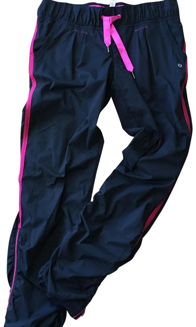 Preload https://item2.tradesy.com/images/lululemon-black-with-hot-pink-trim-track-activewear-pants-size-10-m-22471676-0-2.jpg?width=400&height=650
