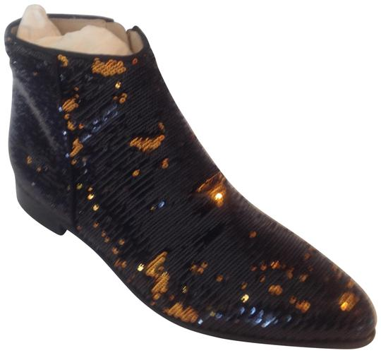 Preload https://item1.tradesy.com/images/black-and-gold-blazing-wave-bootsbooties-size-eu-39-approx-us-9-regular-m-b-22472715-0-1.jpg?width=440&height=440