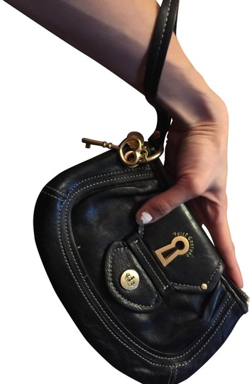 Preload https://item2.tradesy.com/images/juicy-couture-with-gold-details-black-leather-clutch-22472781-0-2.jpg?width=440&height=440