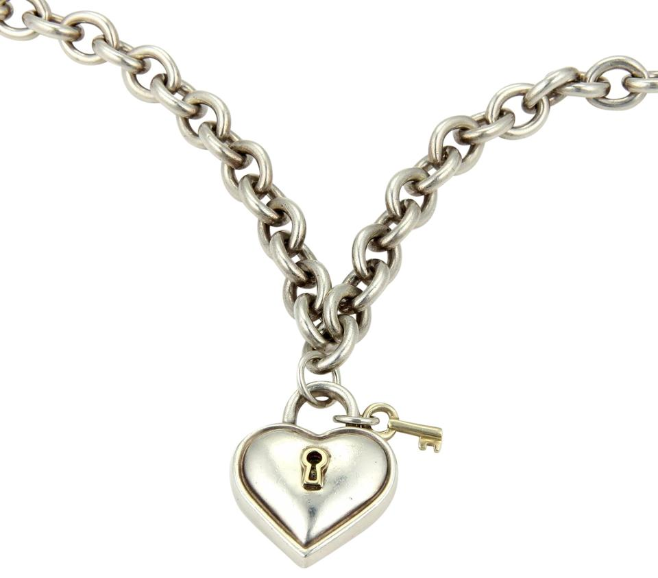 d8c0a6be2ea2 Tiffany   Co. Vintage Sterling 18k Yellow Gold Heart Padlock   Key Necklace  Image 0 ...