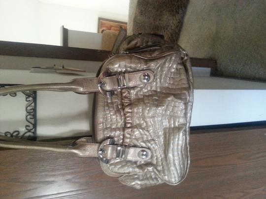 Kathy Vanzeland Silver Hardware Satchel in light Creamy gold / Beutiful Teal color inside no marks or scraches lovey