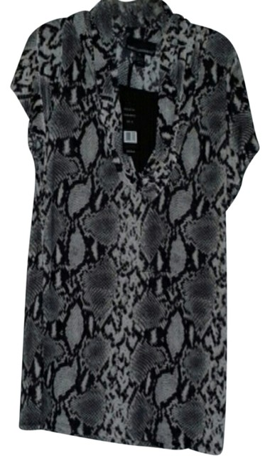 Isabella Rodriguez Top black and white snake pattern