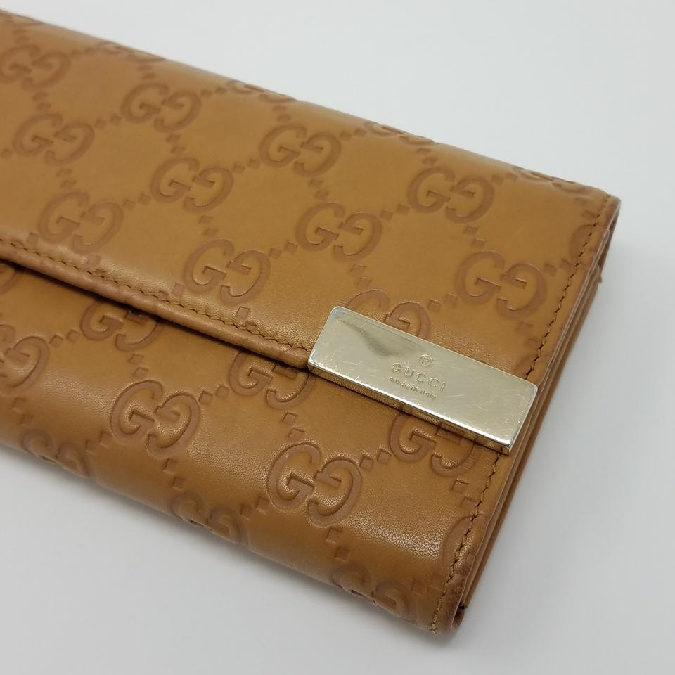 18c832468b9 Gucci Beige Brown Gold Caramel Guccissima Embossed Leather Continental  Wallet