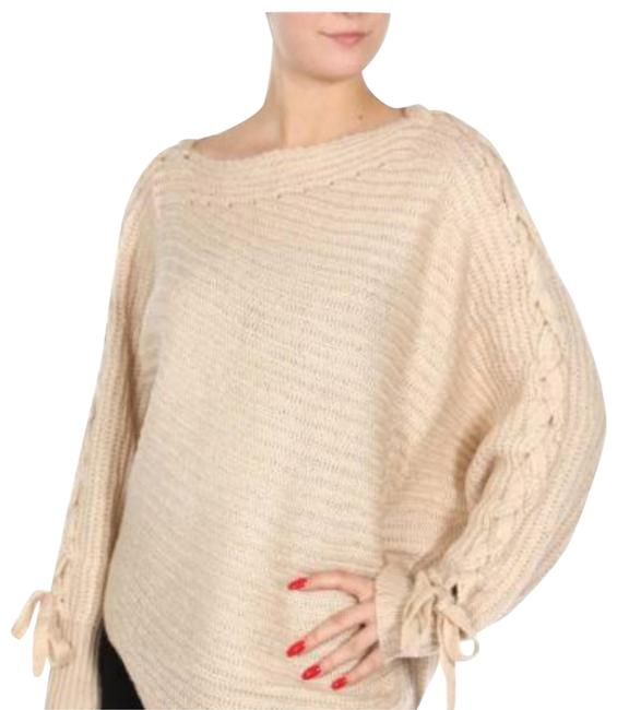 Preload https://item1.tradesy.com/images/cream-uneven-criss-cross-arms-with-tie-at-the-cuff-sweaterpullover-size-8-m-22499390-0-1.jpg?width=400&height=650