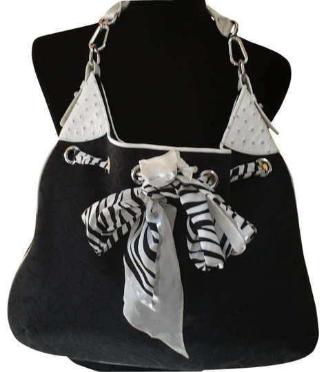 Preload https://item4.tradesy.com/images/bebe-ostrich-black-and-white-fabric-faux-leather-hobo-bag-22499593-0-1.jpg?width=440&height=440