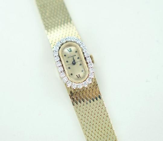 LeCoultre LADIES 14KT YELLOW GOLD LECOULTRE WATCH WITH DIAMOND BEZEL 1.20ATW