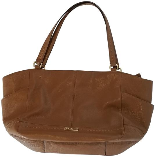 Preload https://item1.tradesy.com/images/coach-carrie-tan-brown-leather-tote-22499865-0-4.jpg?width=440&height=440