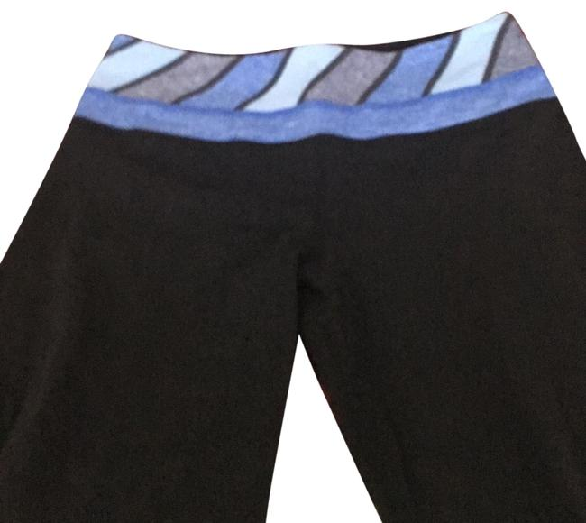 Preload https://item3.tradesy.com/images/lululemon-black-with-blue-waistband-groove-activewear-pants-size-4-s-22500152-0-1.jpg?width=400&height=650