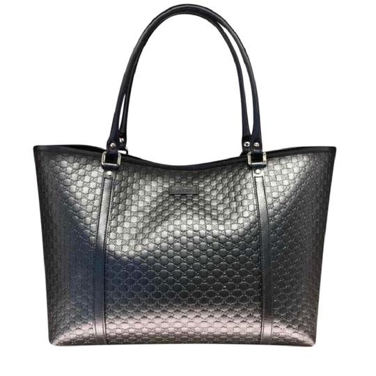 Preload https://item5.tradesy.com/images/gucci-gg-leather-black-tote-22500224-0-0.jpg?width=440&height=440