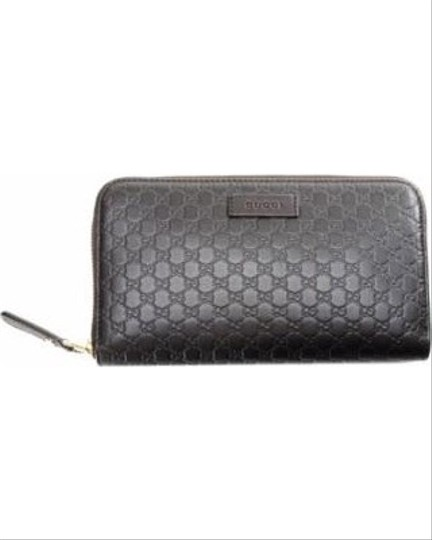 Preload https://item4.tradesy.com/images/gucci-brown-leather-with-zipper-around-wallet-22505473-0-2.jpg?width=440&height=440