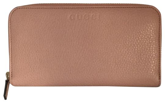 Preload https://img-static.tradesy.com/item/22505473/gucci-leather-with-zipper-around-wallet-0-1-540-540.jpg
