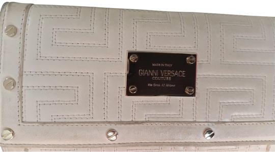 Preload https://img-static.tradesy.com/item/22505750/versace-white-leather-with-gold-tone-hardware-wallet-0-1-540-540.jpg