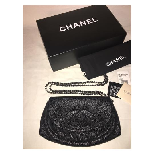 Preload https://item1.tradesy.com/images/chanel-wallet-on-chain-classic-cc-woc-black-caviar-silver-leather-cross-body-bag-22506235-0-5.jpg?width=440&height=440