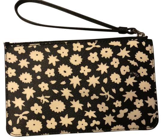 Preload https://item5.tradesy.com/images/coach-corner-zip-small-graphic-floral-print-silverblack-multi-canvas-wristlet-22506824-0-1.jpg?width=440&height=440