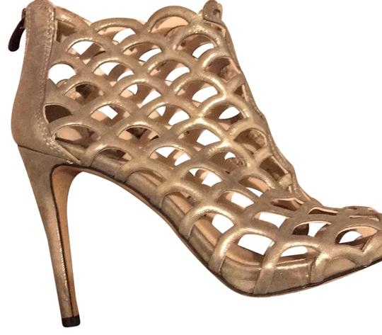 Preload https://item2.tradesy.com/images/goldsilver-formal-shoes-size-us-75-narrow-aa-n-22507271-0-1.jpg?width=440&height=440