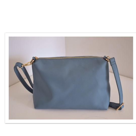 Preload https://item2.tradesy.com/images/bebe-powder-blue-faux-leather-cross-body-bag-22507456-0-0.jpg?width=440&height=440