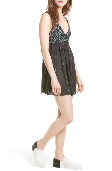 Preload https://img-static.tradesy.com/item/22508556/free-people-black-glitter-girl-minidress-size-s-night-out-dress-size-4-s-0-0-650-650.jpg