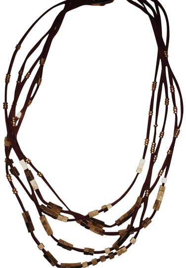 Preload https://img-static.tradesy.com/item/22509430/anthropologie-gold-and-burgundy-suede-necklace-0-1-540-540.jpg