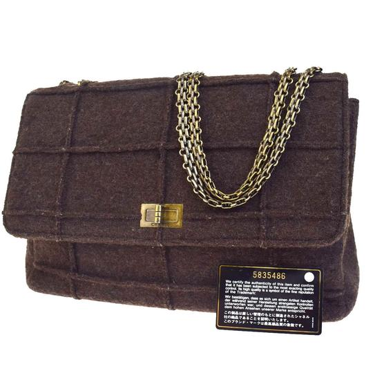 Preload https://img-static.tradesy.com/item/22516528/chanel-classic-flap-identification-logos-chain-shoulder-brown-wool-satchel-0-0-540-540.jpg