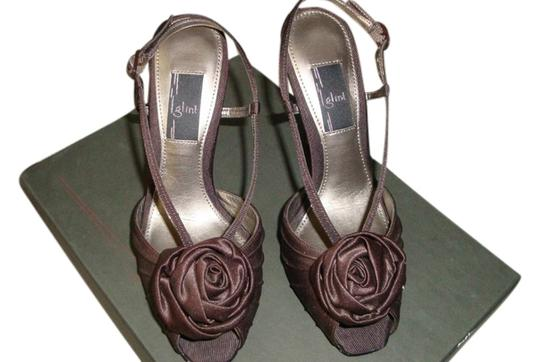 Preload https://item1.tradesy.com/images/glint-brown-satin-strappy-dancing-party-sandals-size-us-5-regular-m-b-2252845-0-0.jpg?width=440&height=440
