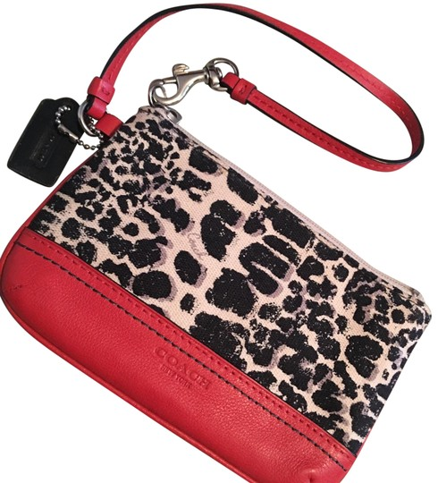 Preload https://img-static.tradesy.com/item/22528945/coach-deep-black-coral-ocelot-canvas-and-leather-wristlet-0-1-540-540.jpg