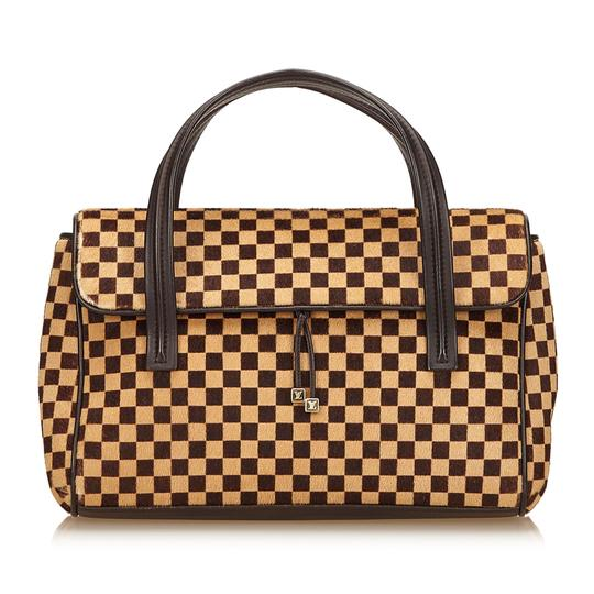 Preload https://item4.tradesy.com/images/louis-vuitton-damier-sauvage-lionne-brown-natural-material-x-pony-hair-x-leather-x-others-baguette-22542988-0-0.jpg?width=440&height=440