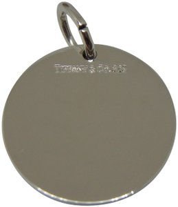 Tiffany & Co. sterling silver medium size plain round tag