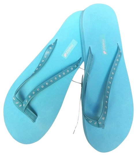 Preload https://item4.tradesy.com/images/turquoise-and-silver-glitter-zori-sandals-size-us-75-regular-m-b-2255328-0-0.jpg?width=440&height=440