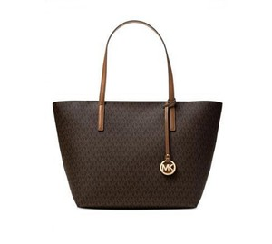6cdebebaf75d Added to Shopping Bag. Michael Kors Tote in Brown. Michael Kors Signature Hayley  Large East West ...