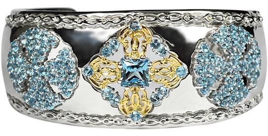 Preload https://img-static.tradesy.com/item/22560520/ny-collection-two-tone-womens-blue-topaz-cuff-bangle-luxury-sterling-silver-7-bracelet-0-1-540-540.jpg