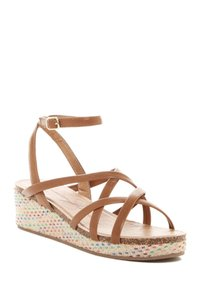 Jessica Simpson Brown with red and orange beading. Sandals