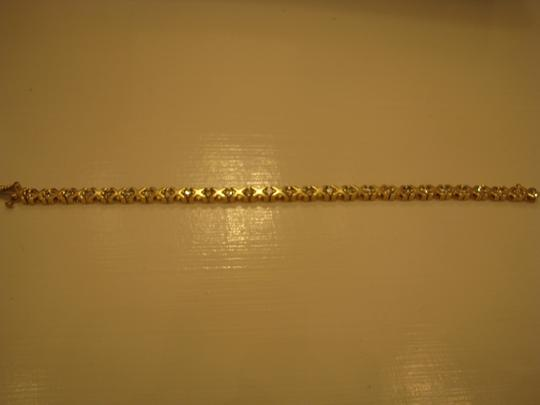 Diamond Jeweler 14k Gold and Diamond XO Hugs and Kisses Tennis Bracelet
