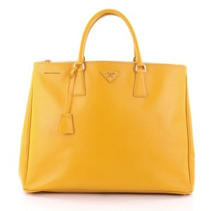 8a555323d7af Added to Shopping Bag. Prada Leather Tote in Yellow. Prada Double Lux Zip  Saffiano Large ...