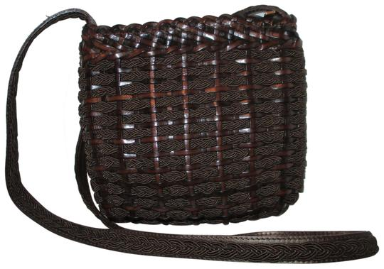 Preload https://img-static.tradesy.com/item/22600067/vintage-woven-fabric-brown-leather-and-textile-cross-body-bag-0-1-540-540.jpg