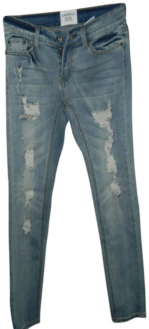 Preload https://img-static.tradesy.com/item/22600140/blue-distressed-cotton-viscose-rayon-blend-rip-skinny-jeans-size-27-4-s-0-1-650-650.jpg