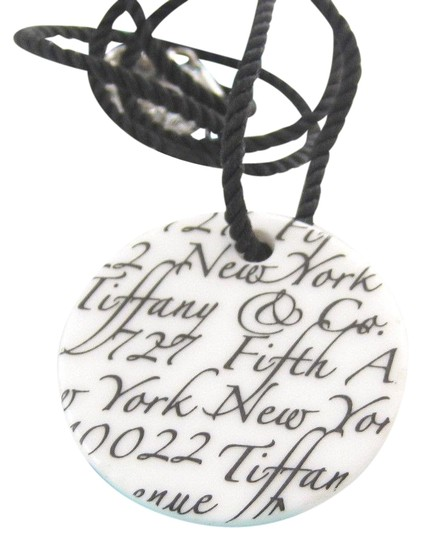 Preload https://img-static.tradesy.com/item/22601179/tiffany-and-co-white-notes-bone-disc-sterling-silver-necklace-0-1-540-540.jpg