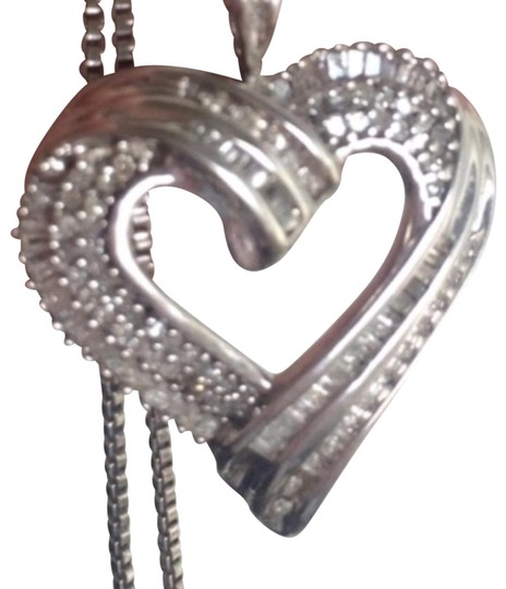 Preload https://img-static.tradesy.com/item/22601186/silver-solid-in-heart-necklace-0-1-540-540.jpg